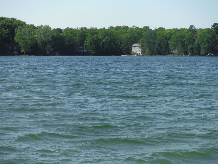 Main body of lake house in back ground.