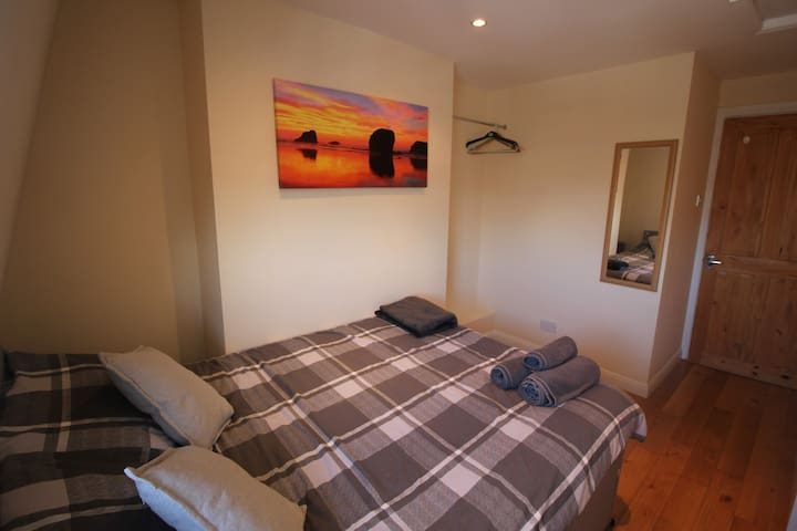 Comfy cosy double bedroom with hanging rail.