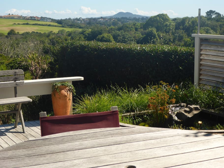 Enjoy the private deck with unobstructed views of native trees, sea and Rangitoto island.