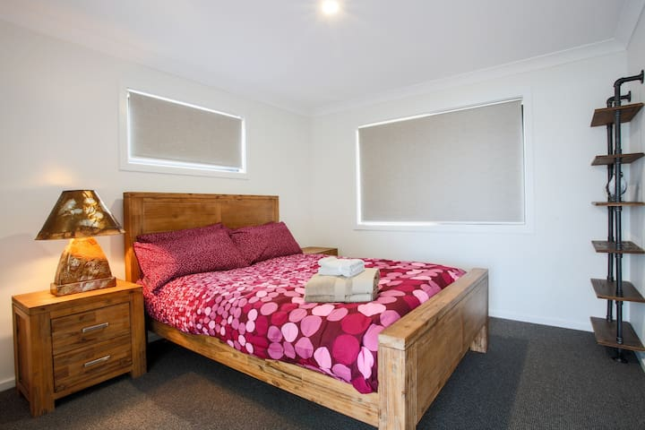 Master bedroom with queen bed and private ensuite