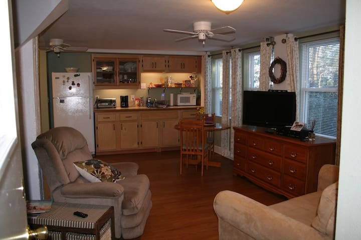 kitchen with microwave, toaster oven, coffee pot,  refrigerator, and dinette