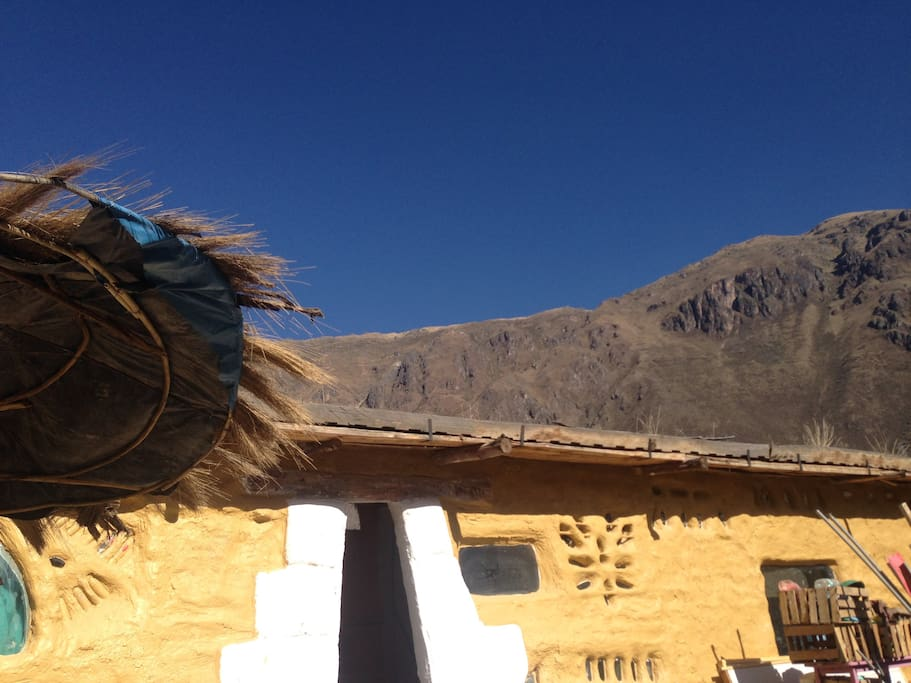 Our sustainable home on a hot clear day in the dry season.