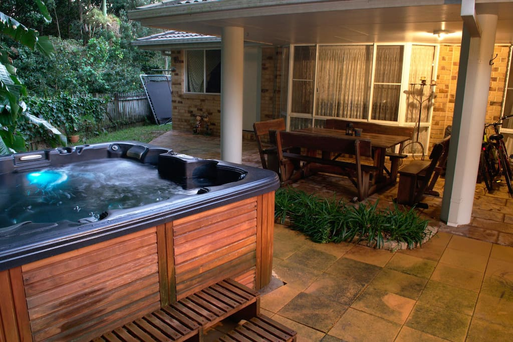 Relax in our hot-tub in our private back yard adjacent to a nature reserve.