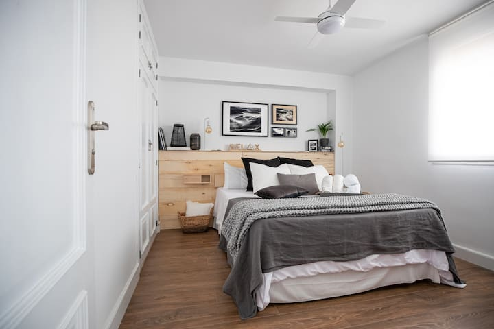 The master bedroom, with a nice and spacious double bed for two.