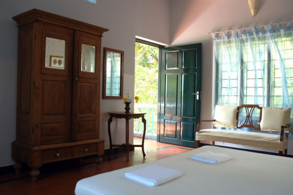 spacious room with king size bed, comfortably and stylishly decorated