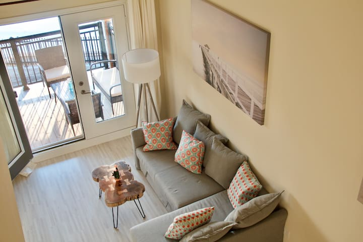 First floor is open to above and leads to an outside patio. Sectional couch easily transforms into a bed capable of sleeping 2 people.
