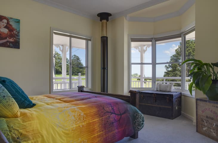 Second Bedroom with comfortable Queen bed and Views over the rolling hills