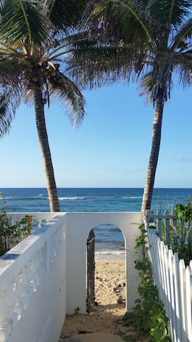 Just walk through your gate and sink your toes in the sand-steps from your back door