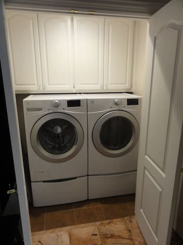 Large capacity washer and dryer are available downstairs, as well as an iron and ironing board.