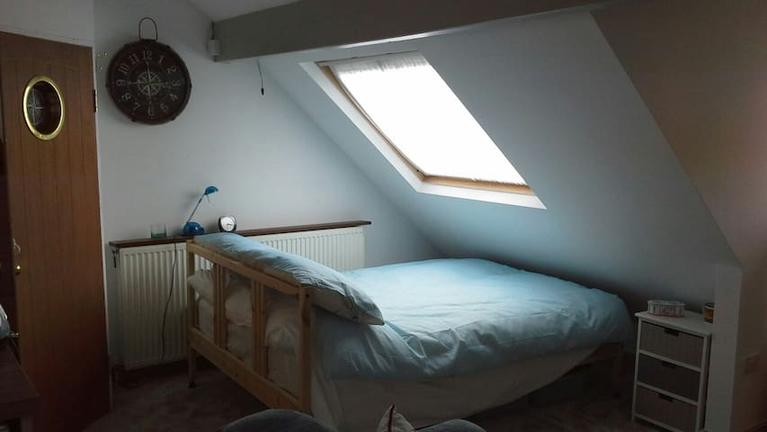 Very comfy double bed under Velux window. Black out blind inc