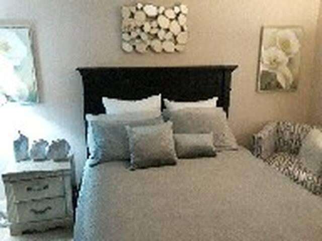 Master bedroom w/ half bath and locking bedroom.
