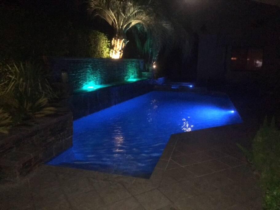 Pool & hot tub at night