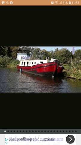 Stay on a historical houseboat close to Amsterdam
