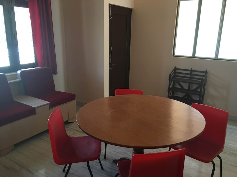 living and dining area, bright natural light, fully equipped kitchen