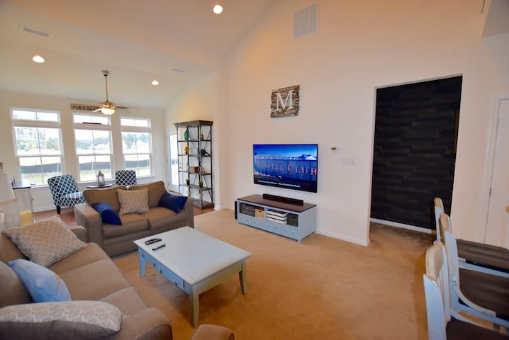 Great Room features Sloped Ceilings, large HDTV and wide open design providing spacial relaxation