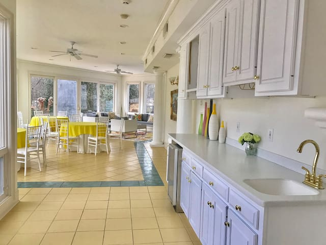 Our Florida room with wet bar, tables and entertaining area with tv.