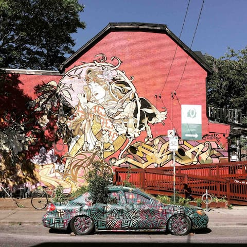 Kensington market mural and car planter.