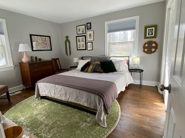 """King bedroom, platform bed with Zinus 13"""" Euro Pocket Spring Hybrid Mattress. Dresser and large walkin closet."""