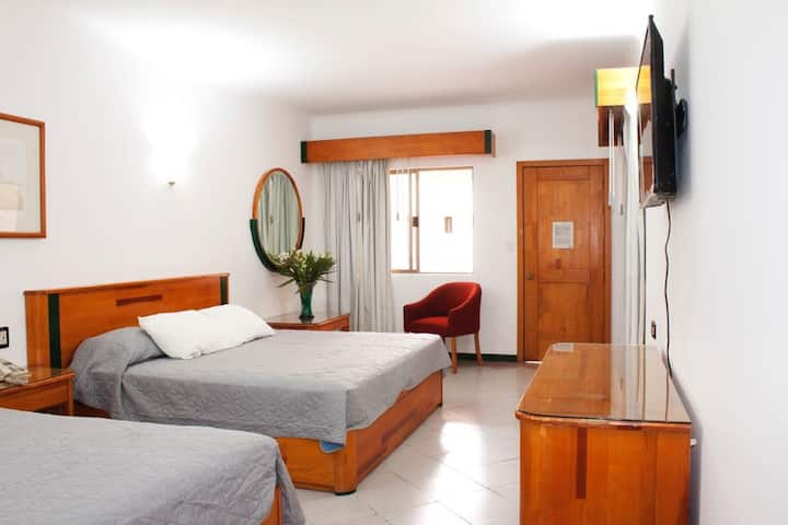 IN FRONT OF THE MARKETS.  Room with  2 beds