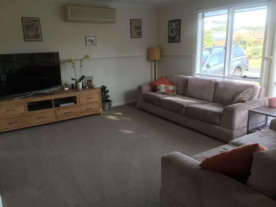 Comfortable lounge room with airconditioning and Foxtel