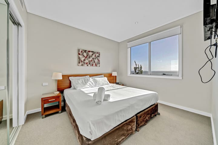 Sleep easy in a generous king-sized bed within the main bedroom. It comes with a TV and storage space for your belongings.