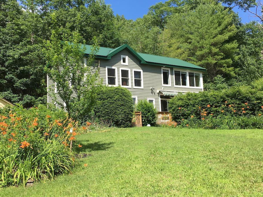 Our house with the second floor wall of windows overlooking the Catskill mountains