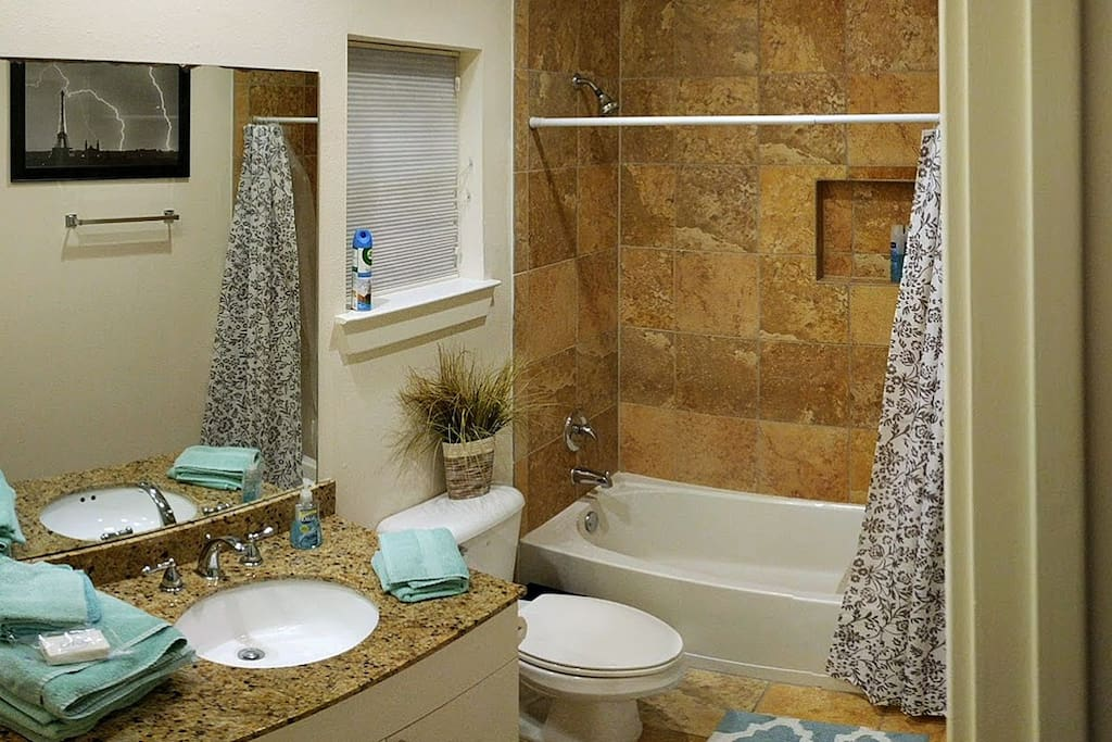 Upscale bathroom- always clean with fresh towels and washcloths. A new bar of soap and shared shampoo/conditioner are provided.