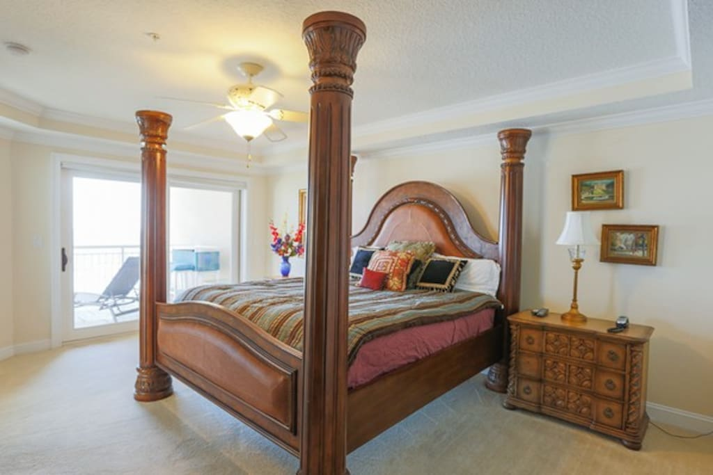 masterbedroom  w 4 poster bed  overlooking ocean and large balcony