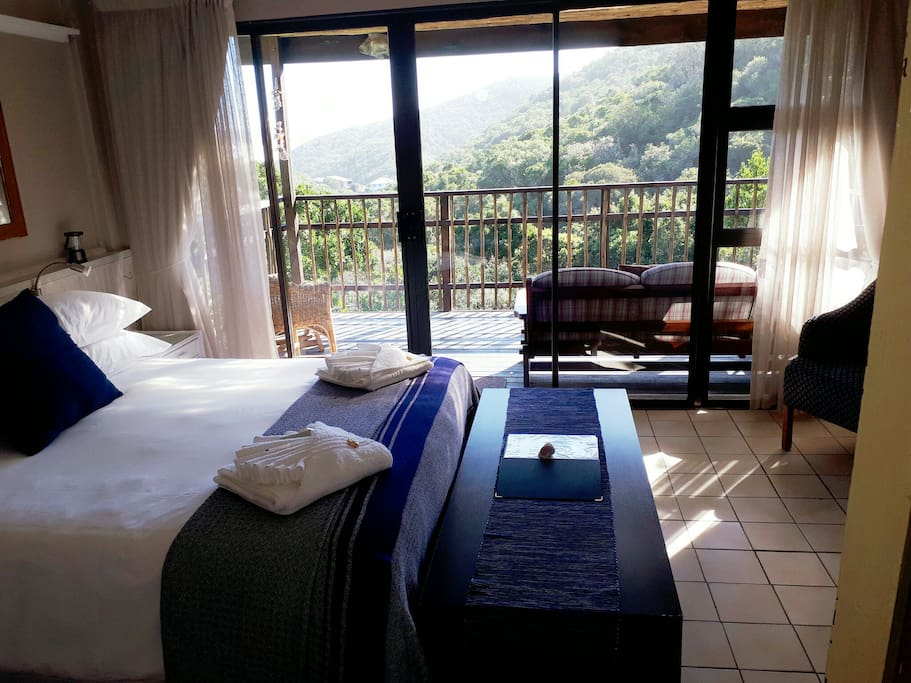 Main bedroom with private balcony. Ideal space for morning coffee.