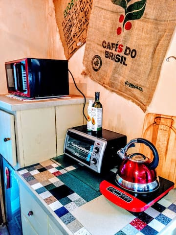 Microwave, toaster oven, mini fridge (lower left corner) and induction hot plate. All available for you to cook your own meals if you like.