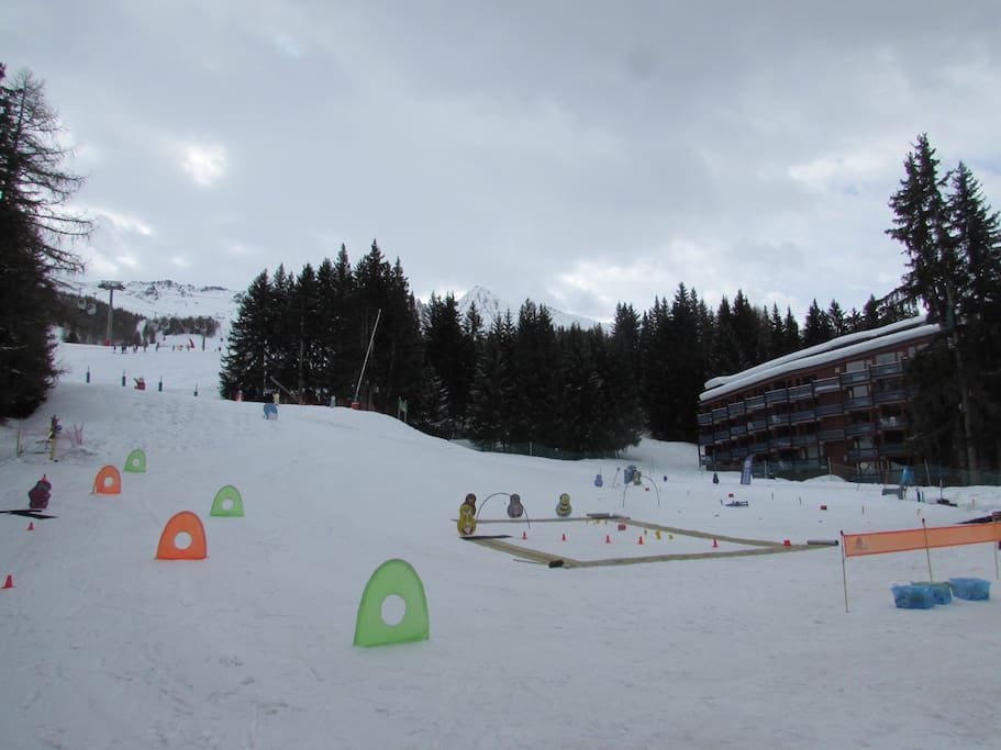 View from the kids ski school to the apartment on the right and slopes above
