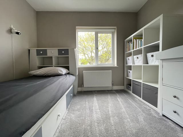 Bedroom 3. Single bed + travel cot if required. This room also has a baby monitor which can be viewed in the mancave. Parents, we got you.