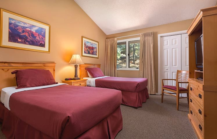 Two comfy twin-beds make the second bedroom perfect for additional guests