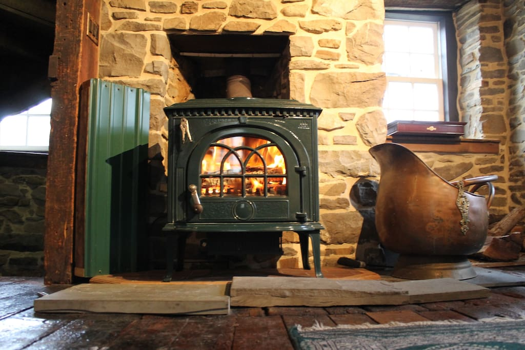 Cozy wood burning stove. Wood included with your rental
