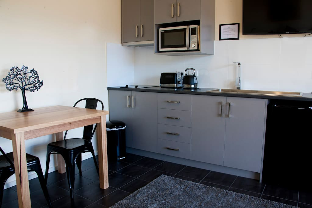 Modern well equipped kitchenette and dining facilities