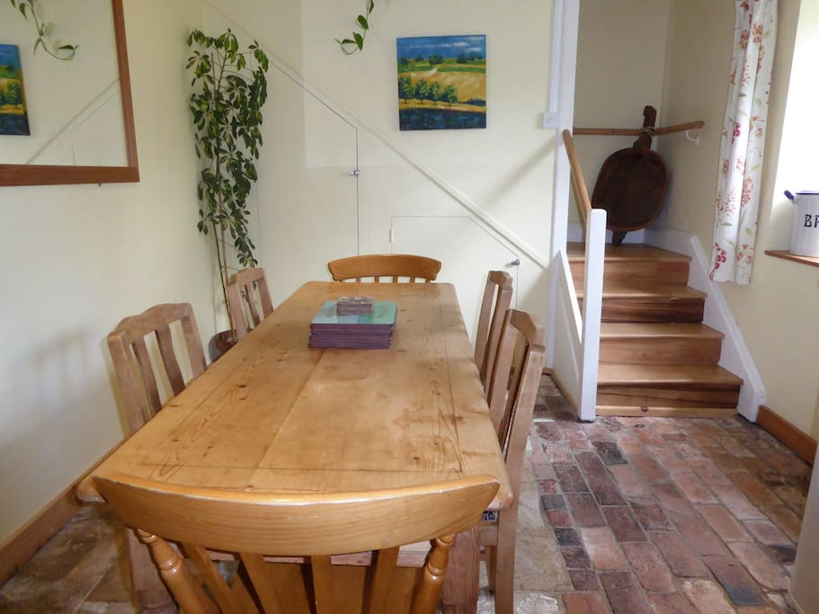 Dining area - Orchard Cottage with staircase leading from this room to Bedroom 1.
