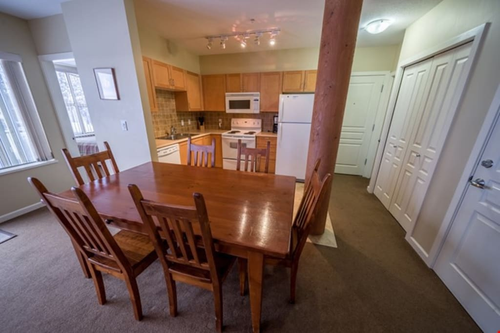 Bright open dining area with access to the kitchen for easy meal prep and entertaining family and friends