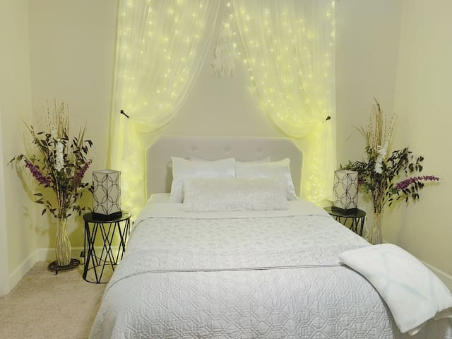 COZY BEDROOM WITH CURTAIN LIGHT HEADBOARD