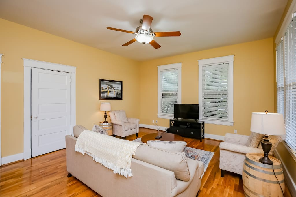 Newly re-furnished, this cozy living room has space for five to gather around a flat-screen TV.