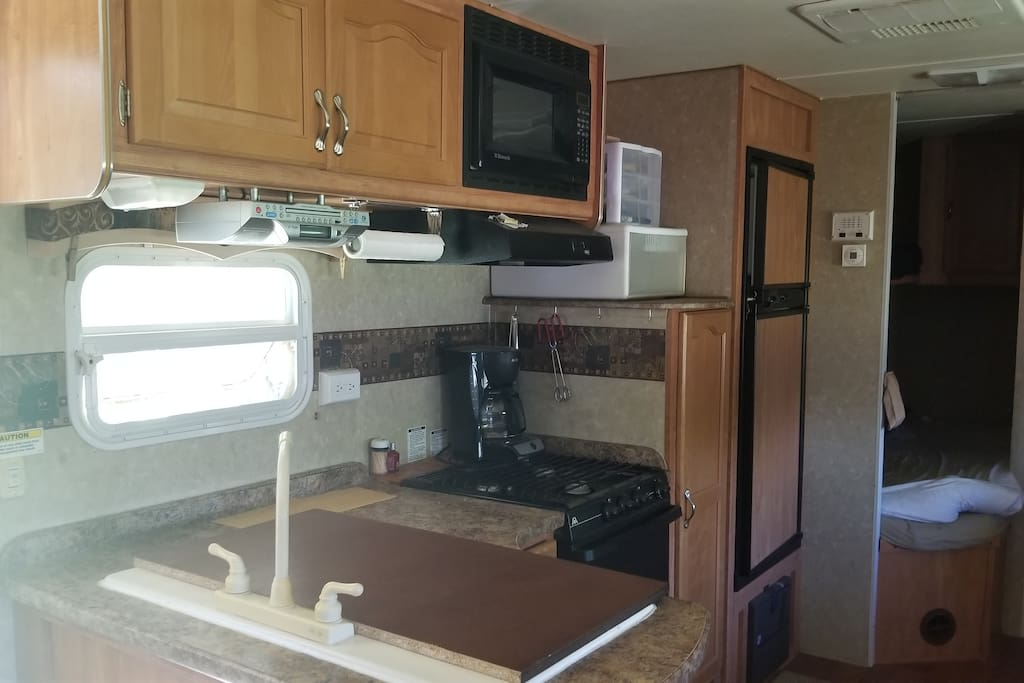 You have use of the kitchen area in the camper with all the basic cookware