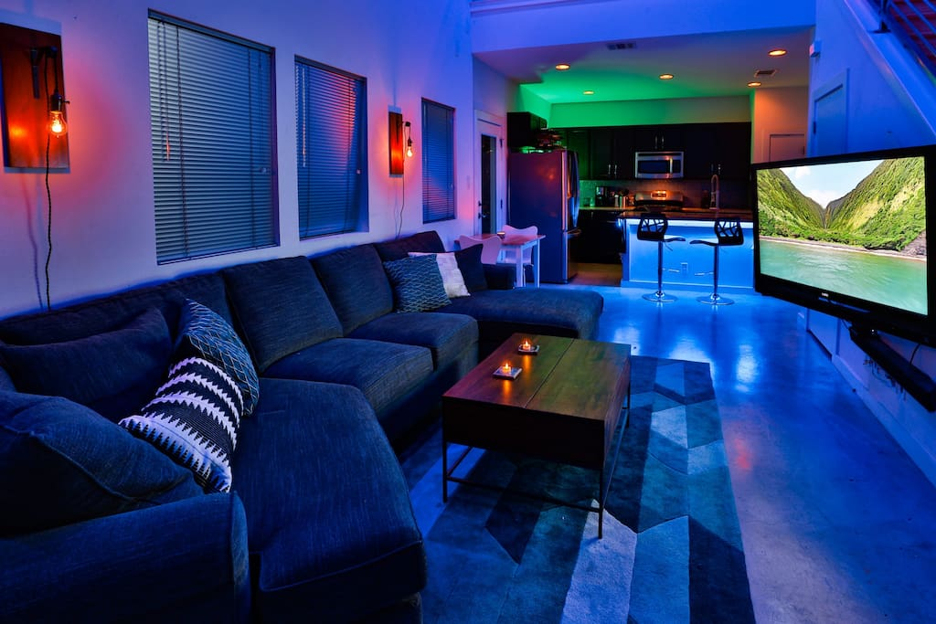Large sectional in the living room with full spectrum LED lights.