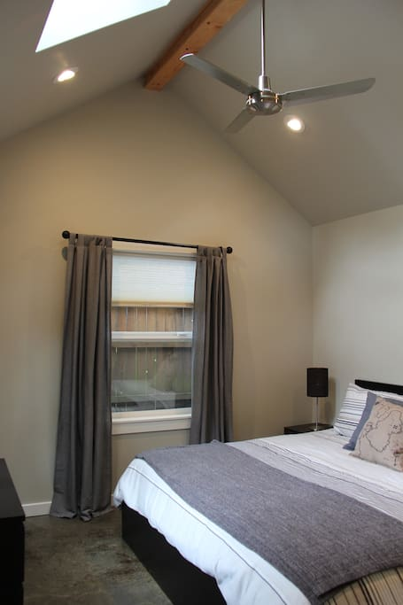 Bedroom: includes king sized bed, dresser, luggage rack, nightstands, skylight, ceiling fan.