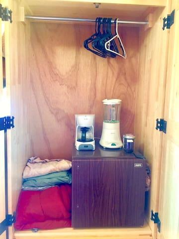 Inside closet: refrigerator, blender, coffee maker