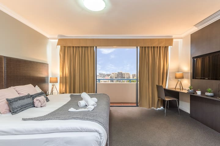 Sleep easy on the plush king bed or wake up and make your way out to the spacious balcony for your morning cup of coffee.