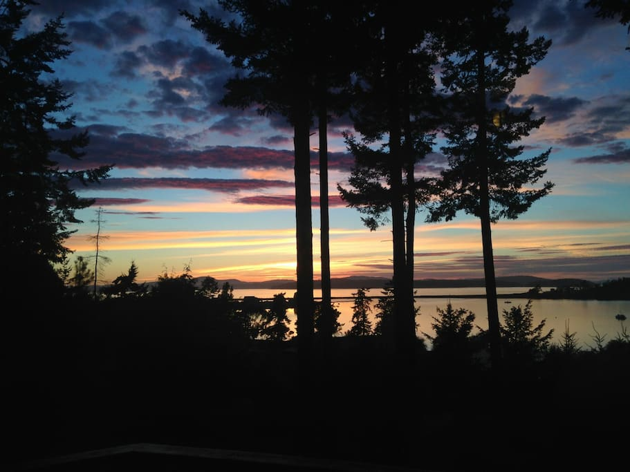 View from the deck at sunset across Fishermans Bay and San Juan Channel towards San Juan Island.