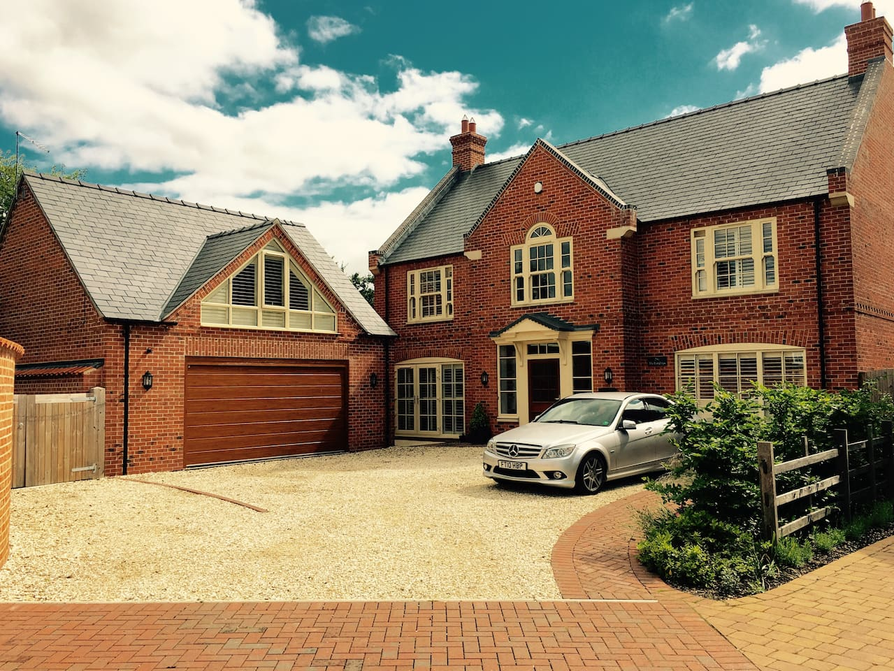 House is set back and located in the centre of our gorgeous village in Lincolnshire. Room is self contained above the garage.