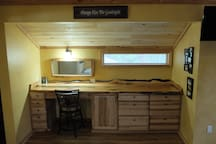 large countertop with ample storage made from live edge juniper