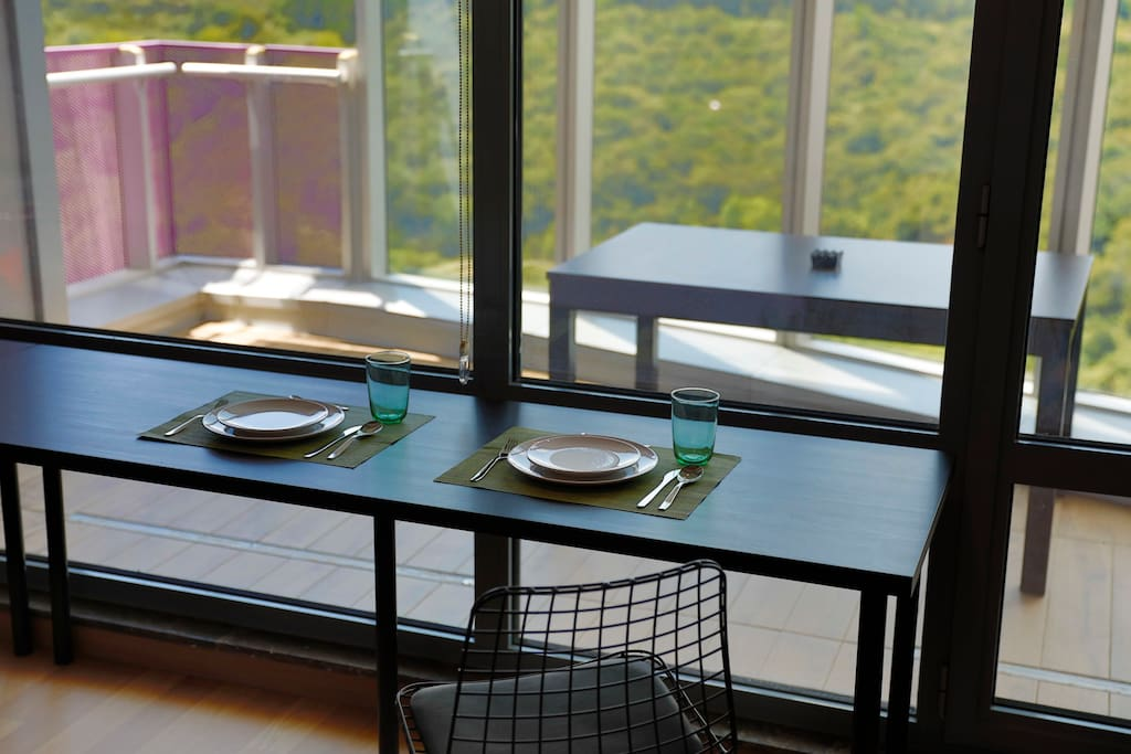 indoor dinning table with  jungle view