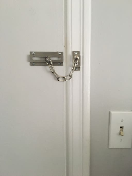 A chain lock on the bedroom door.