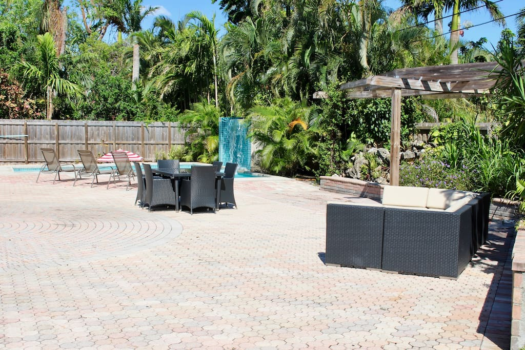HUGE backyard with outdoor dining options, heated pool, children's playground, and additional grass and shrubbery spaces for playing in!
